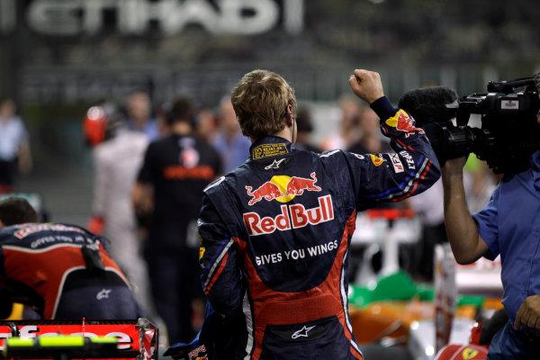 Yas Marina Circuit, Abu Dhabi, United Arab Emirates12th November 2011.Sebastian Vettel, Red Bull Racing RB7 Renault, celebrates pole in Parc Ferme. Portrait. World Copyright:Glenn Dunbar/LAT Photographic ref: Digital Image _G7C4543