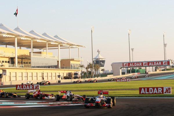 Lewis Hamilton (GBR) McLaren MP4/26 leads at the start of the race. Formula One World Championship, Rd 18, Abu Dhabi Grand Prix, Race, Yas Marina Circuit, Abu Dhabi, UAE, Sunday 13 November 2011.  BEST IMAGE