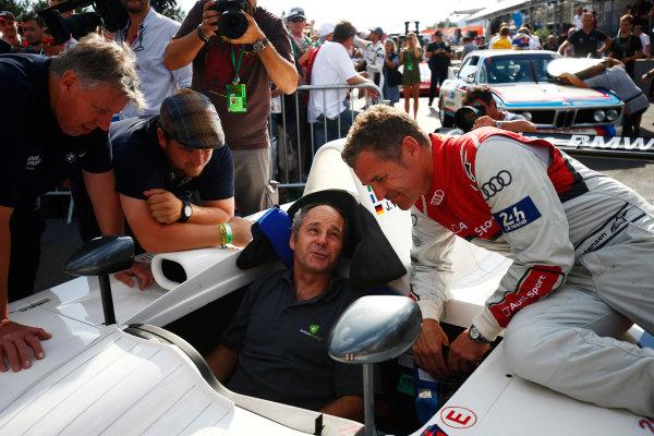 Red Bull Ring, Spielberg, Austria. Saturday 08 July 2017. Gerhard Berger, seated in a BMW V12 LMR sportscar, talks to Tom Kristensen. World Copyright: Andy Hone/LAT Images ref: Digital Image _ONZ0860