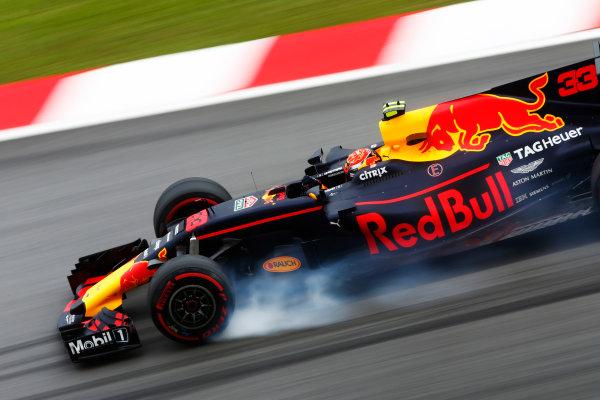 Sepang International Circuit, Sepang, Malaysia. Friday 29 September 2017. Max Verstappen, Red Bull Racing RB13 TAG Heuer, locks a front wheel. World Copyright: Andy Hone/LAT Images  ref: Digital Image _ONY2451