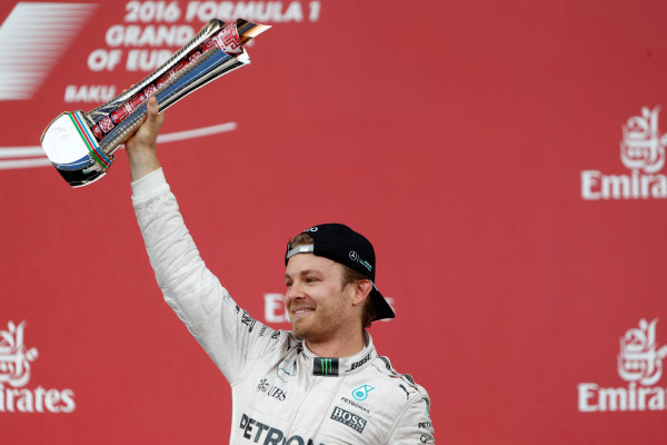 Baku City Circuit, Baku, Azerbaijan. Sunday 19 June 2016. Nico Rosberg, Mercedes AMG, 1st Position, on the podium with his trophy. World Copyright: Glenn.Dunbar/LAT Photographic ref: Digital Image _V2I3739
