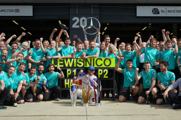 Silverstone, Northamptonshire, UK Sunday 10 July 2016. Lewis Hamilton, Mercedes AMG, 1st Position, celebrates with his team and their weekend haul of trophies. World Copyright: Steve Etherington/LAT Photographic ref: Digital Image SNE21839