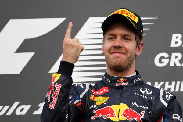 Bahrain International Circuit, Sakhir, Bahrain22nd April 2012Sebastian Vettel, Red Bull Racing, 1st position, celebrates on the podium.World Copyright: Andy Hone/LAT Photographicref: Digital Image HONY8649
