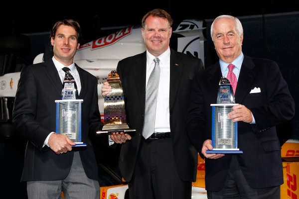 6 December, 2012, Indianapolis, Indiana USA Will Power and Roger Penske with Jim Campbell from Chevy Racing and 2nd place and Mario Andretti Road Course trophies.(c)2012, Russell LaBounty LAT Photo USA .