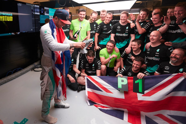 Circuit of the Americas, Austin, Texas, United States of America. Sunday 25 October 2015. Lewis Hamilton, Mercedes AMG empties champagne from his shoe in the garage during celebrations. World Copyright: Steve Etherington/LAT Photographic. ref: Digital Image SNE16213