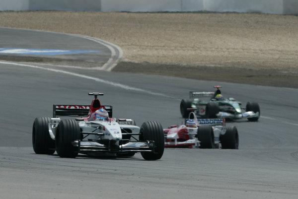 2003 European Grand Prix - Sunday Race, Nurburgring, Germany. 29th June 2003 Jenson Button, BAR Honda 005, leads Olivier Panis, Toyota TF103, and Mark Webber, Jaguar R4, action.World Copyright: Steve Etherington/LAT Photographic ref: Digital Image Only