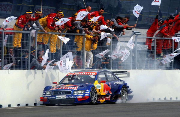 2004 DTM Championship Brno,Czech Republic. 18th - 19th September.Winner Mattias Ekstrom (Abt Sportsline Audi A4) lights up his rear tyres as he crosses the line to the cheers of his team. Action World Copyright: Andre Irlmeier/LAT Photographic ref: Digital Image Only