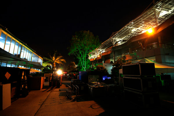Sepang International Circuit, Sepang, Kuala Lumpur, Malaysia. Sunday 30 March 2014. Night falls on the busy paddock as the circus packs away to head to the next round. World Copyright: Charles Coates/LAT Photographic. ref: Digital Image _N7T8919