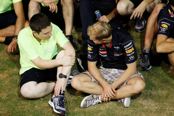 Marina Bay Circuit, Singapore. Sunday 22nd September 2013.  Sebastian Vettel during the Red Bull Racing celebration team photo.  World Copyright: Jed Leicester/LAT Photographic. ref: Digital Image _JEL3284