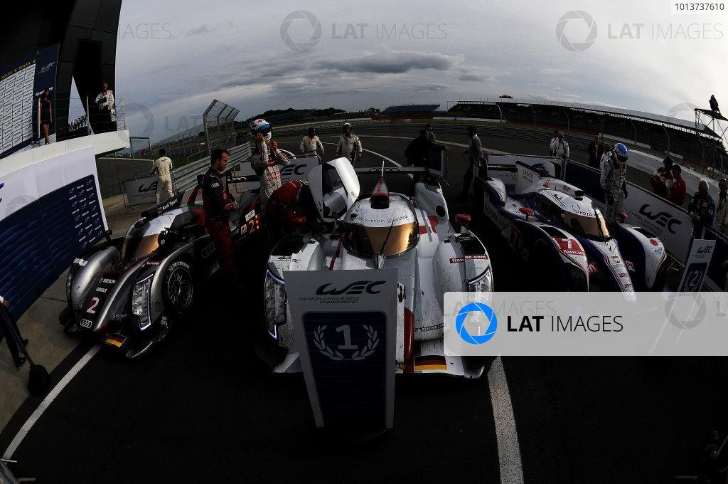 Silverstone, England. 24th - 26th August 2012. Rd 4.Tom Kristensen (DNK), Allan McNish (GBR), Audi Sport Team Joest, Audi R18 Ultra, Andre Lotterer (GER), Marcel Fassler (CHE), Benoit Treluyer (FRA), Audi Sport Team Joest, Audi R18 E-Tron Quatrro, Alexander Wurz (AUT), Nicolas Lapierre (FRA), Kazuki Nakajima (JPN), Toyota Racing, Toyota TS030 Hybrid, in pard ferme, portrait, atmosphere, World Copyright: Chris Bird/LAT Photographic.Ref:  _CJB8505