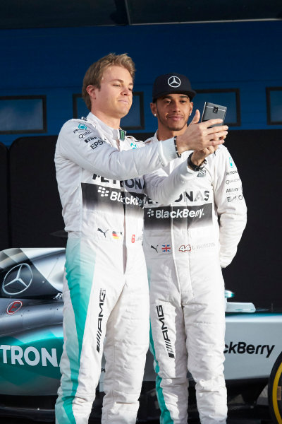 2015 F1 Pre Season Test 1 - Day 1 Circuito de Jerez, Jerez, Spain. Sunday 1 February 2015. Nico Rosberg, Mercedes AMG, takes a selfie with Lewis Hamilton, Mercedes AMG, at the launch of the Mercedes W06. World Copyright: Steve Etherington/LAT Photographic. ref: Digital Image SNE26186