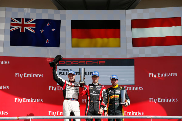 2014 Porsche Supercup. Sunday 2 November 2014. Michael Ammermuller, No.4 Lechner Racing Team, 1st Position, Earl Bamber, No.19 Fach Auto Tech, 2nd Position, and Philipp Eng, No.12 Team Project 1, 3rd Position, on the podium.  World Copyright: /LAT Photographic. ref: Digital Image _89P8528