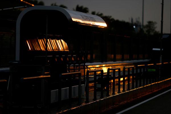 Sepang International Circuit, Sepang, Kuala Lumpur, Malaysia. Thursday 26 March 2015. The sun sets in the pit lane. World Copyright: Andrew Hone/LAT Photographic. ref: Digital Image _ONY8226