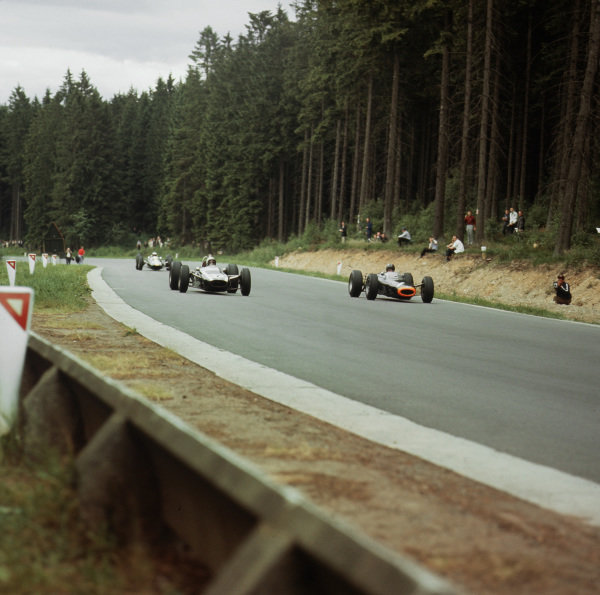 Spa-Francorchamps, Belgium.12-14 June 1964.Bruce McLaren (Cooper T73 Climax) and Graham Hill (number 1, BRM P261). They were classified in 2nd and 5th positions respectively.Ref-3/1243.World Copyright - LAT Photographic