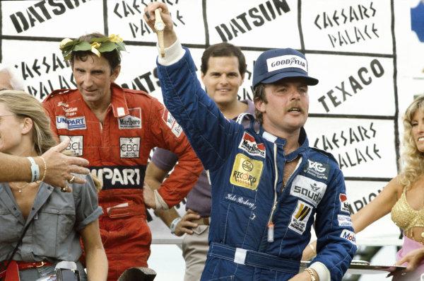 Las Vegas, Nevada, USA. 23 - 25 September 1982.The new World Champion Keke Rosberg celebrates on the podium with John Watson, portrait.World Copyright: LAT Photographic.Ref: 82LV