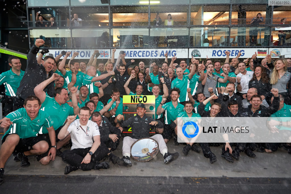 Albert Park, Melbourne, Australia. Sunday 16 March 2014. Nico Rosberg, Mercedes AMG, 1st Position, celebrates with his team. World Copyright: Steve Etherington/LAT Photographic. ref: Digital Image SNE13841 copy