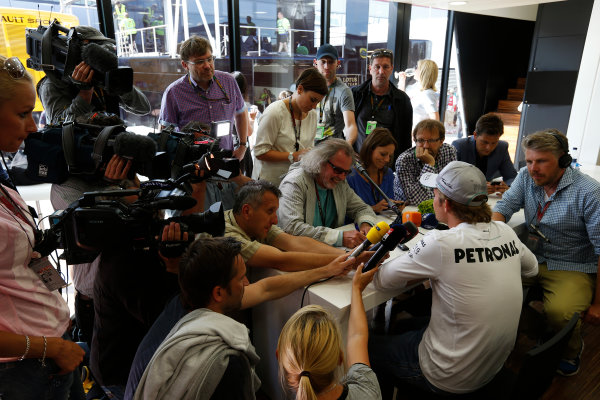 Silverstone, Northamptonshire, England 30th June 2013 Nico Rosberg, Mercedes AMG faces questions from the media after the stewards enquiry World Copyright: Charles Coates/  ref: Digital Image _N7T4989
