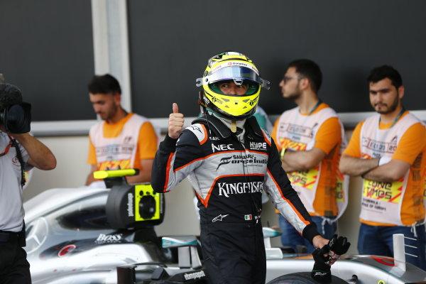 Baku City Circuit, Baku, Azerbaijan. Saturday 18 June 2016. Sergio Perez, Force India, in Parc Ferme after Qualifying. World Copyright: HoneLAT Photographic ref: Digital Image _ONY1265