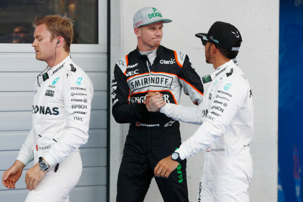 Red Bull Ring, Spielberg, Austria. Saturday 02 July 2016. Nico Hulkenberg, Force India and Lewis Hamilton, Mercedes AMG shake hands in parc ferme. World Copyright: Glenn Dunbar/LAT Photographic ref: Digital Image _V2I3067
