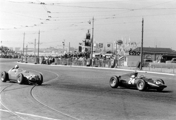 1960 Portuguese Grand Prix Oporto, Portugal. 12-14 August 1960 Dan Gurney (BRM P48) leads Wolfgang von Trips (Ferrari Dino 246). Von Trips finished in 4th position World Copyright: LAT PhotographicRef: Autosport b&w print