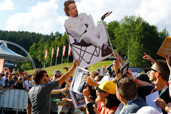Red Bull Ring, Spielberg, Austria. Thursday 06 July 2017. Fernando Alonso, McLaren, signs a cardboard cutout for fans. World Copyright: Steven Tee/LAT Images ref: Digital Image _O3I4663