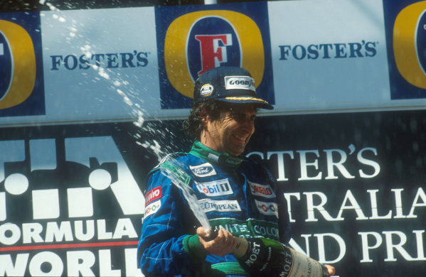 1990 Australian Grand Prix.Adelaide, Australia.2-4 November 1990.Nelson Piquet (Benetton Ford) celebrates 1st position on the podium.Ref-90 AUS 04.World Copyright - LAT Photographic