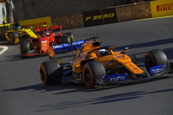 Carlos Sainz Jr., McLaren MCL34, leads Charles Leclerc, Ferrari SF90