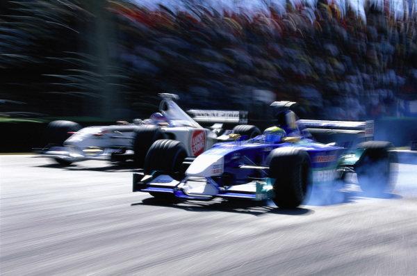 Felipe Massa, Sauber C21 Petronas, locks a wheel as he fights with Jacques Villeneuve, BAR 004 Honda.