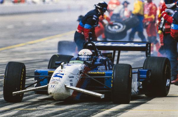 Gil de Ferran, Walker Racing, Reynard 98i Honda, completes a pitstop.
