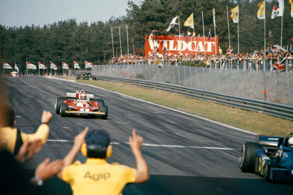Zolder, Belgium. 14th - 16th May 1976. Niki Lauda (Ferrari 312T2), 1st position, crosses the finishing line, action.  World Copyright: LAT Photographic. Ref: 76 BEL 09.