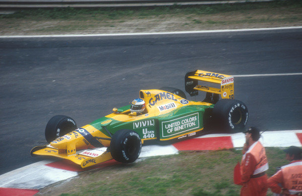 Spa-Francochamps, Belgium.28-30 August 1992.Michael Schumacher (Benetton B192 Ford) 1st position for his maiden Grand Prix win. Here he is going over the kerbs on the entry to the Bus Stop Chicane. 
