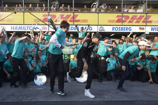 Albert Park, Melbourne, Australia. Sunday 15 March 2015. Lewis Hamilton, Mercedes AMG and Nico Rosberg, Mercedes AMG celebrate with their team after winning the race. World Copyright: Steve Etherington/LAT Photographic. ref: Digital Image SNE11621