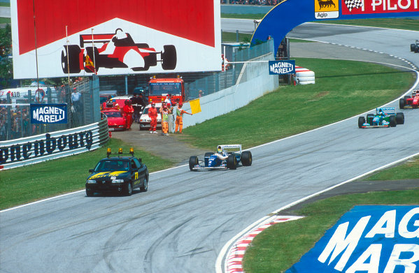 Imola, Italy.29/4-1/5 1994.Ayrton Senna (Williams FW16 Renault) leads the rest of the field behind the safety car which was brought out after the Lehto/Lamy startline shunt.Ref-94 SM 43.World Copyright - LAT Photographic