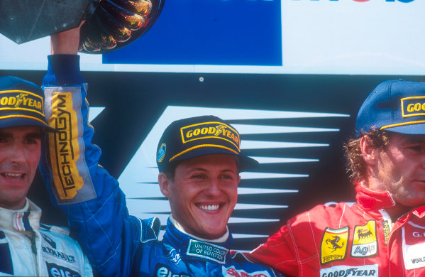 Magny-Cours, France.30/6-2/7 1994.Michael Schumacher (Benetton Ford) celebrates 1st position with Damon Hill (Williams Renault) 2nd position and Gerhard Berger (Ferrari) 3rd position on the podium.Ref-94 FRA 06.World Copyright - LAT Photographic