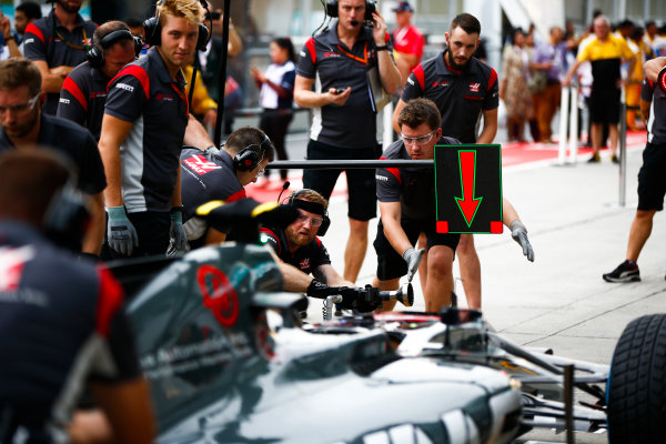 Sepang International Circuit, Sepang, Malaysia. Thursday 28 September 2017. Engineer sat in the cockpit of the Haas VF-17 Ferrari for a practice pit stop. World Copyright: Andy Hone/LAT Images  ref: Digital Image _ONY1144