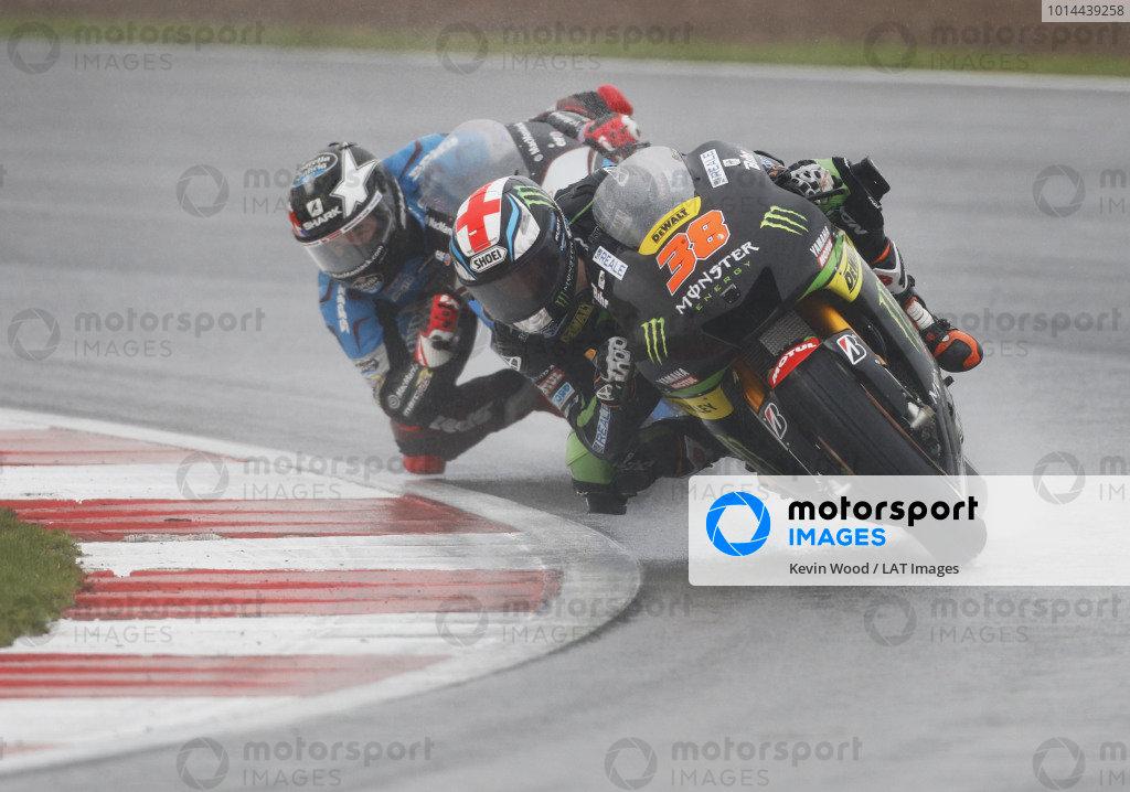 2015 MotoGP Championship.  British Grand Prix.  Silverstone, England. 28th - 30th August 2015.  Bradley Smith, Tech 3 Yamaha, leads Scott Redding, Marc VDS Honda.  Ref: KW7_8341a. World copyright: Kevin Wood/LAT Photographic