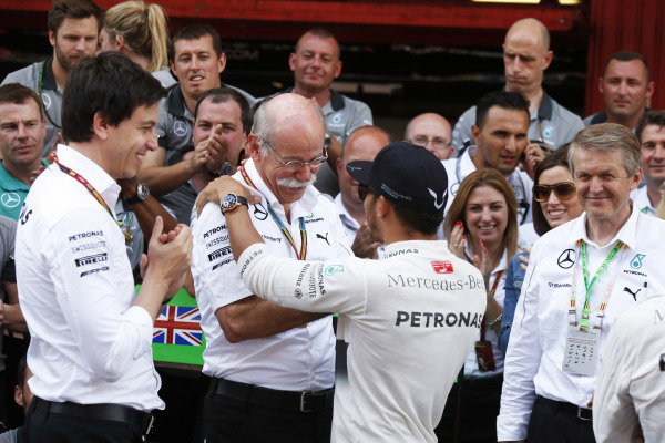 Circuit de Catalunya, Barcelona, Spain. Sunday 11 May 2014. Toto Wolff, Executive Director (Business), Mercedes AMG, Dr Dieter Zetsche, CEO, Mercedes Benz, Lewis Hamilton, Mercedes AMG, 1st Position, and the Mercedes team celebrate. World Copyright: Charles Coates/LAT Photographic. ref: Digital Image _N7T1301