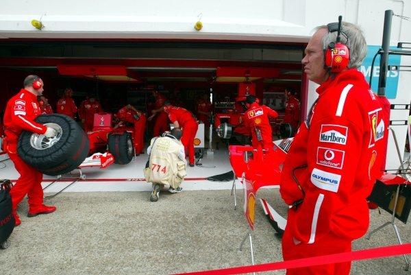 Rory Byrne (RSA) Ferrari Chief Designer oversees work in the Ferrari pit.Formula One World Championship, Rd4, San Marino Grand Prix, Imola, Italy, 19 April 2003.DIGITAL IMAGE