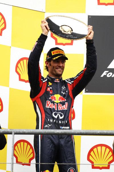 Mark Webber (AUS) Red Bull Racing on the podium.  Formula One World Championship, Rd 12, Belgian Grand Prix, Race, Spa-Francorchamps, Belgium, Sunday 28 August 2011.