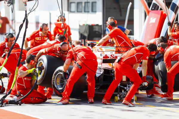 Hungaroring, Budapest, Hungary.  Tuesday 01 August 2017. Charles Leclerc, Ferrari SF70H pit stop.  World Copyright: Joe Portlock/LAT Images  ref: Digital Image _R3I2497