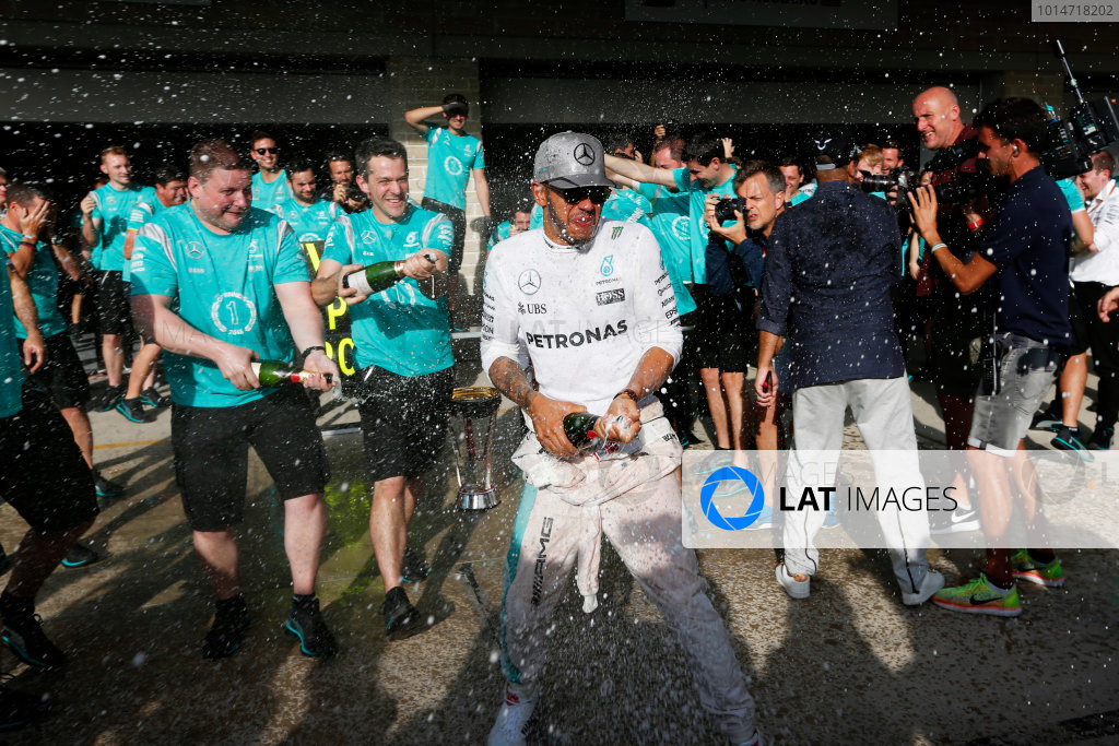 Circuit of the Americas, Austin Texas, USA. Sunday 23 October 2016. Lewis Hamilton, Mercedes AMG, 1st Position, and the Mercedes AMG team celebrate with Champagne. World Copyright: Sam Bloxham/LAT Photographic ref: Digital Image _SBB2157