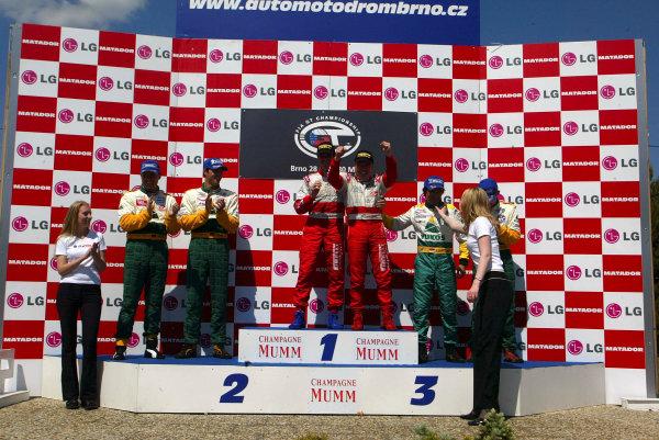 2004 FIA GT ChampionshipBrno, Czech Republic. 30th May 2004.N-GT race winner Fabrizio de Simone and Cristian Pescatori (Ferrari 360 Modena), podium. Maassen/Luhr 2nd, Ortelli/Collard 3rd (Porsche 996 GT3-RS.World Copyright: Photo4/LAT Photographicref: Digital Image Only