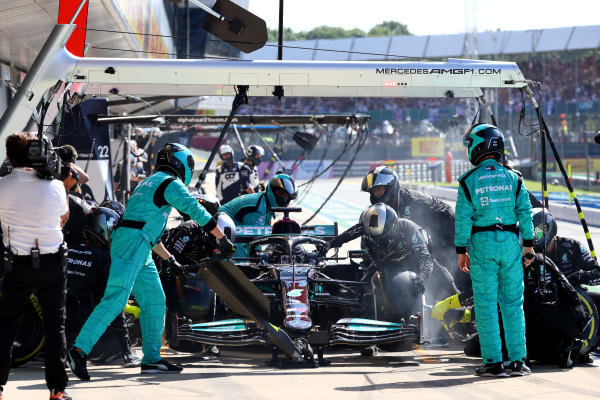 Sir Lewis Hamilton, Mercedes W12, makes a pit stop
