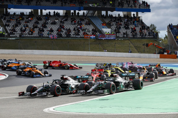 Valtteri Bottas, Mercedes F1 W11 EQ Performance, and Lewis Hamilton, Mercedes F1 W11 EQ Performance, lead the field away at the start