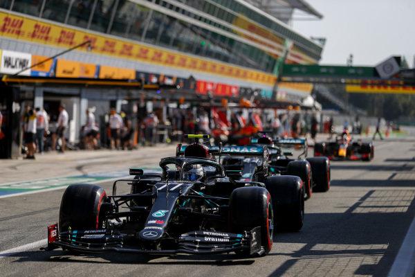 Valtteri Bottas, Mercedes F1 W11 EQ Performance, leads Lewis Hamilton, Mercedes F1 W11 EQ Performance