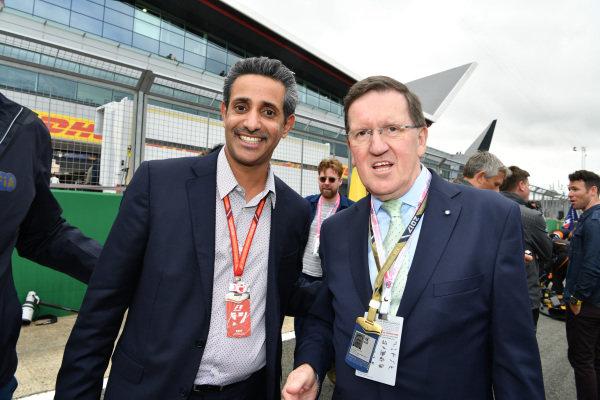 Shaikh Salman bin Isa Al Khalifa (BRN) Chief Executive of Bahrain International Circuit and Lord Robertson (GBR) on the grid at Formula One World Championship, Rd10, British Grand Prix, Race, Silverstone, England, Sunday 16 July 2017. BEST IMAGE
