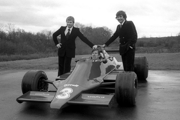 L-R: The 1979 Tyrrell driver line-up: Didier Pironi (FRA); Ken Tyrrell (GBR) Tyrrell Team Owner; Jean-Pierre Jarier (FRA), with the new ground effect Tyrrell 009. Tyrrell 009 Launch, England, Circa late 1978.