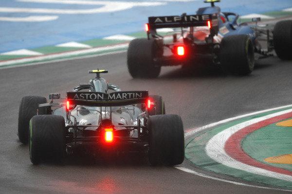 Esteban Ocon, Alpine A521, leads Sebastian Vettel, Aston Martin AMR21