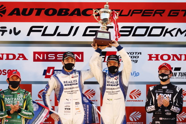 Kiyoto Fujinami & Joao Paulo de Oliveira ( #56 Realize Nissan Automobile Technical College GT-R ), 2nd position in GT300 and 2020 GT300 Drivers' Champions, celebrate on the podium