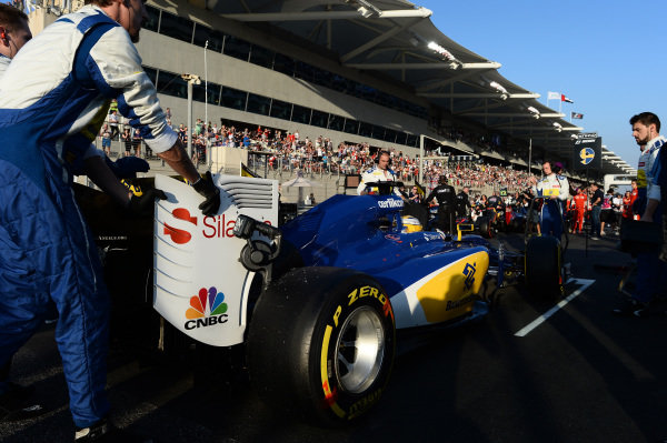 Marcus Ericsson (SWE) Sauber on the grid at Formula One World Championship, Rd19, Abu Dhabi Grand Prix, Race, Yas Marina Circuit, Abu Dhabi, UAE, Sunday 29 November 2015.